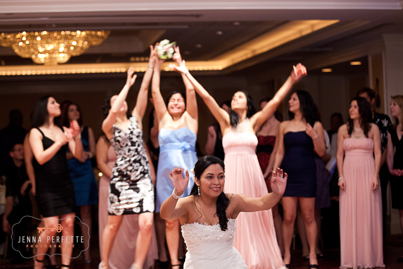bride tosses the bouquet bridesmaids reach for it