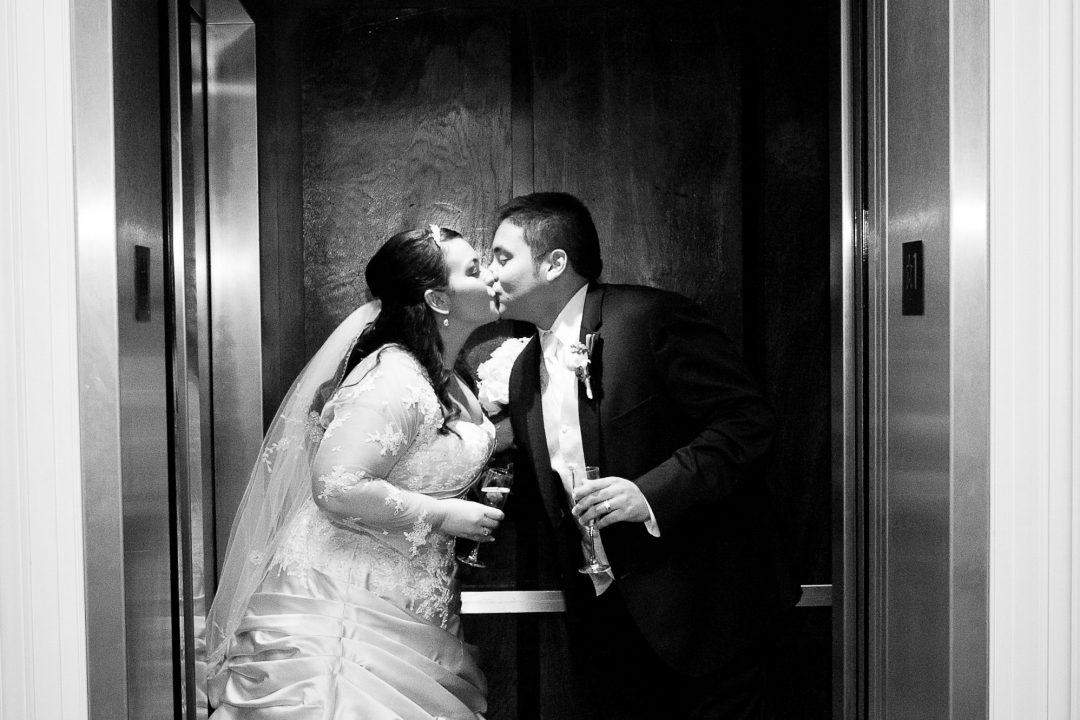 meadow-wood-manor-newlywed-elevator-kiss