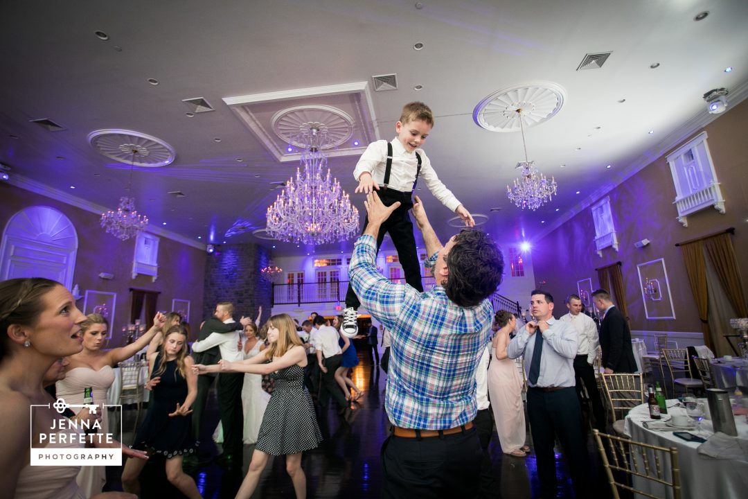 Man Throwing Boy in the Air