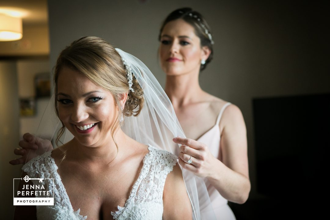 Bride and her Bridesmaid Getting Ready