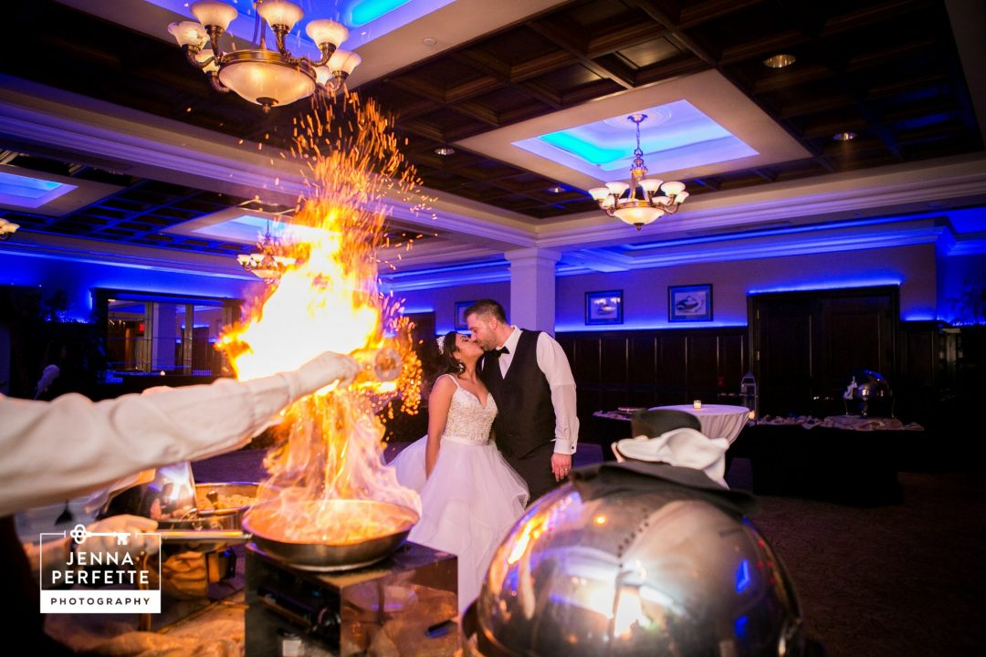 Bride and Groom Next to Cooking Flame