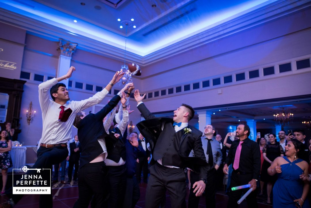 Men Try Catching the Garter Around a Football