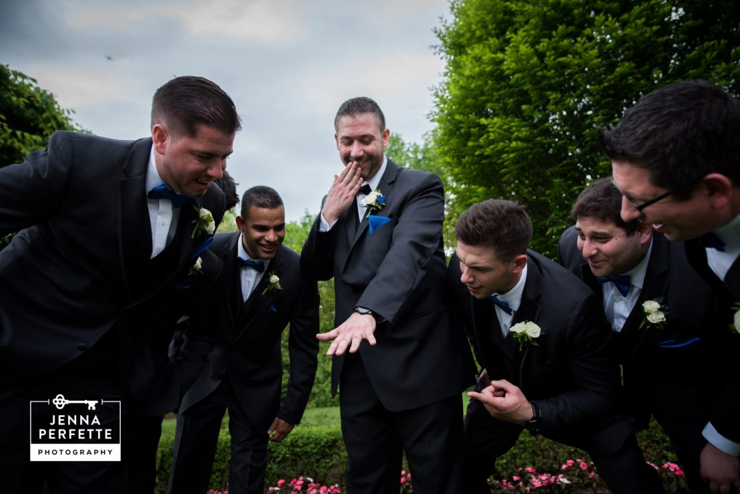 Groom and Groomsmen Looking at Ring
