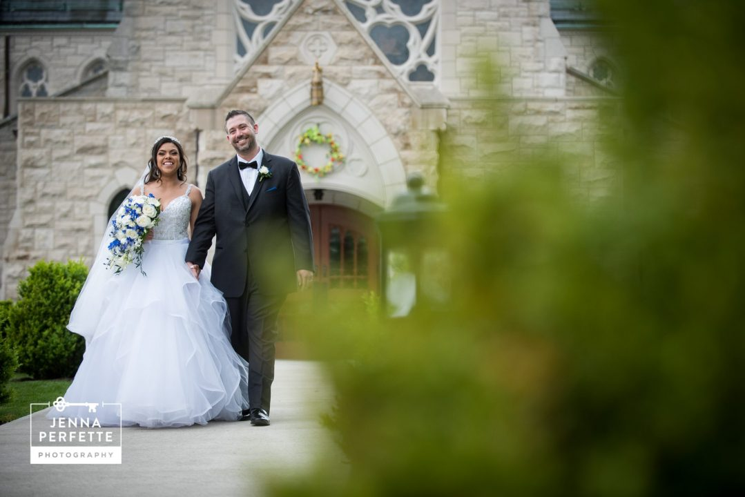 Bride and Groom Hold Hands Outside Church
