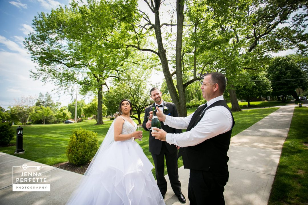 Bride and Groom Popping Champagne Before Reception