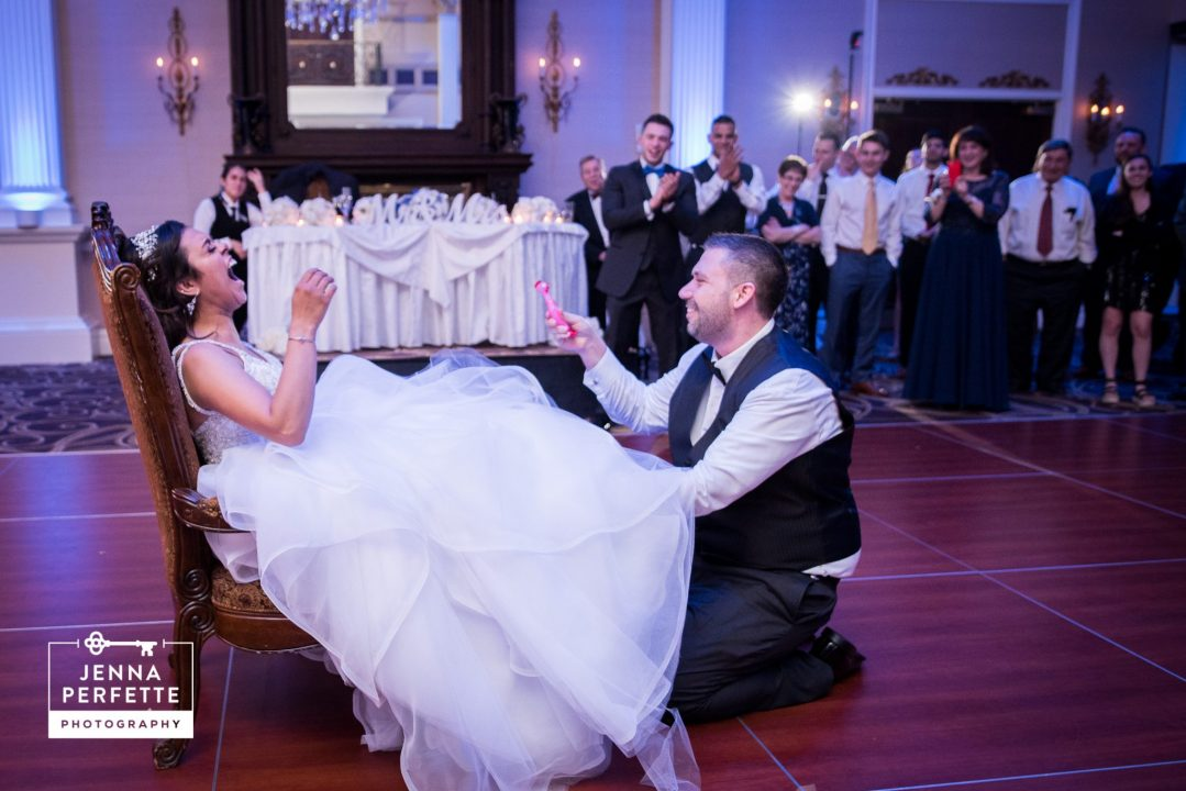Bride and Groom Pull Garter Tossing Prank on Guests