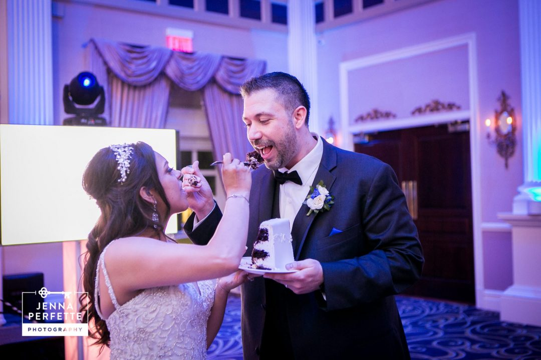 Bride and Groom Sharing Cake