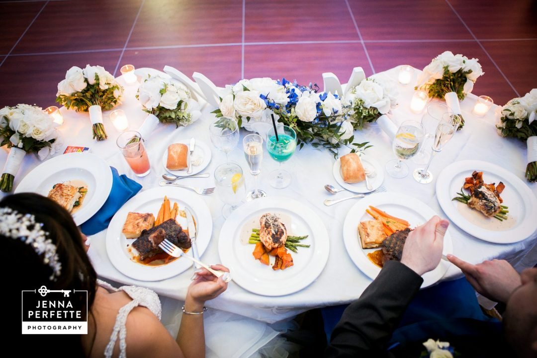Bride and Groom Enjoying Spread of Food