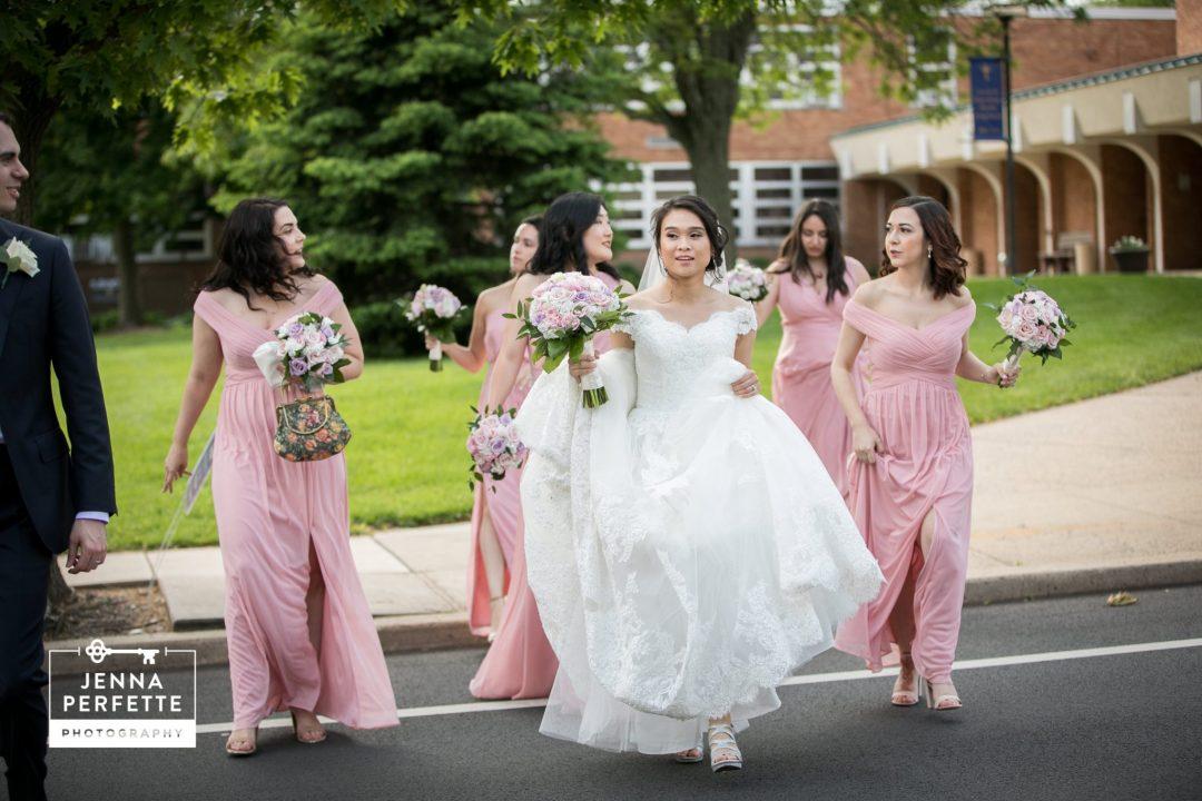 Bride and her Bridesmaids Walking Across Street