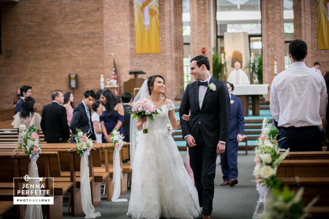 Bride and Groom Walk Down Aisle A Rutgers Love Story Wedding