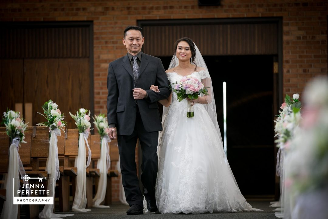 Bride Being Walked Down the Aisle by Her Father