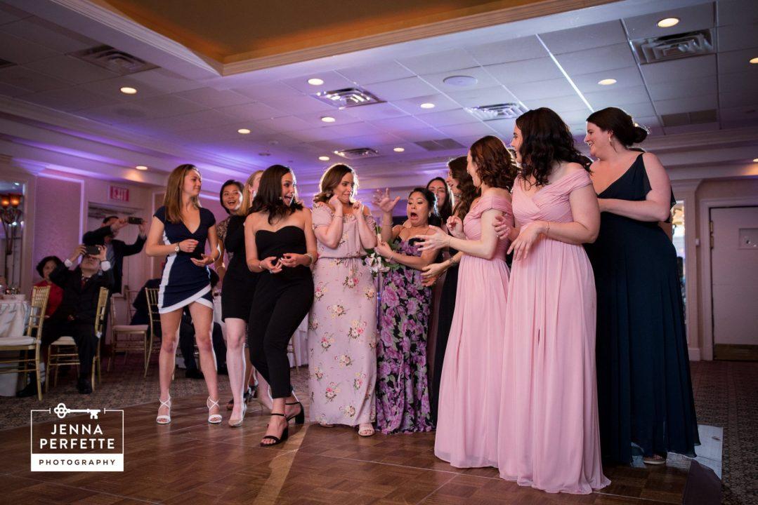 Women Standing for Bouquet Toss