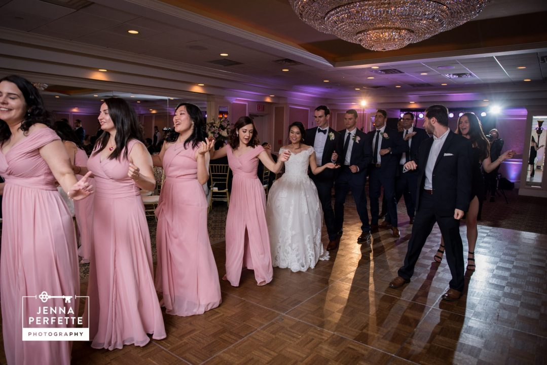 Bride and Groom Dancing With Guests